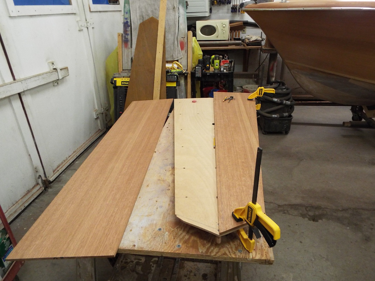 Fitting the mahogany skin to the front deck vent.