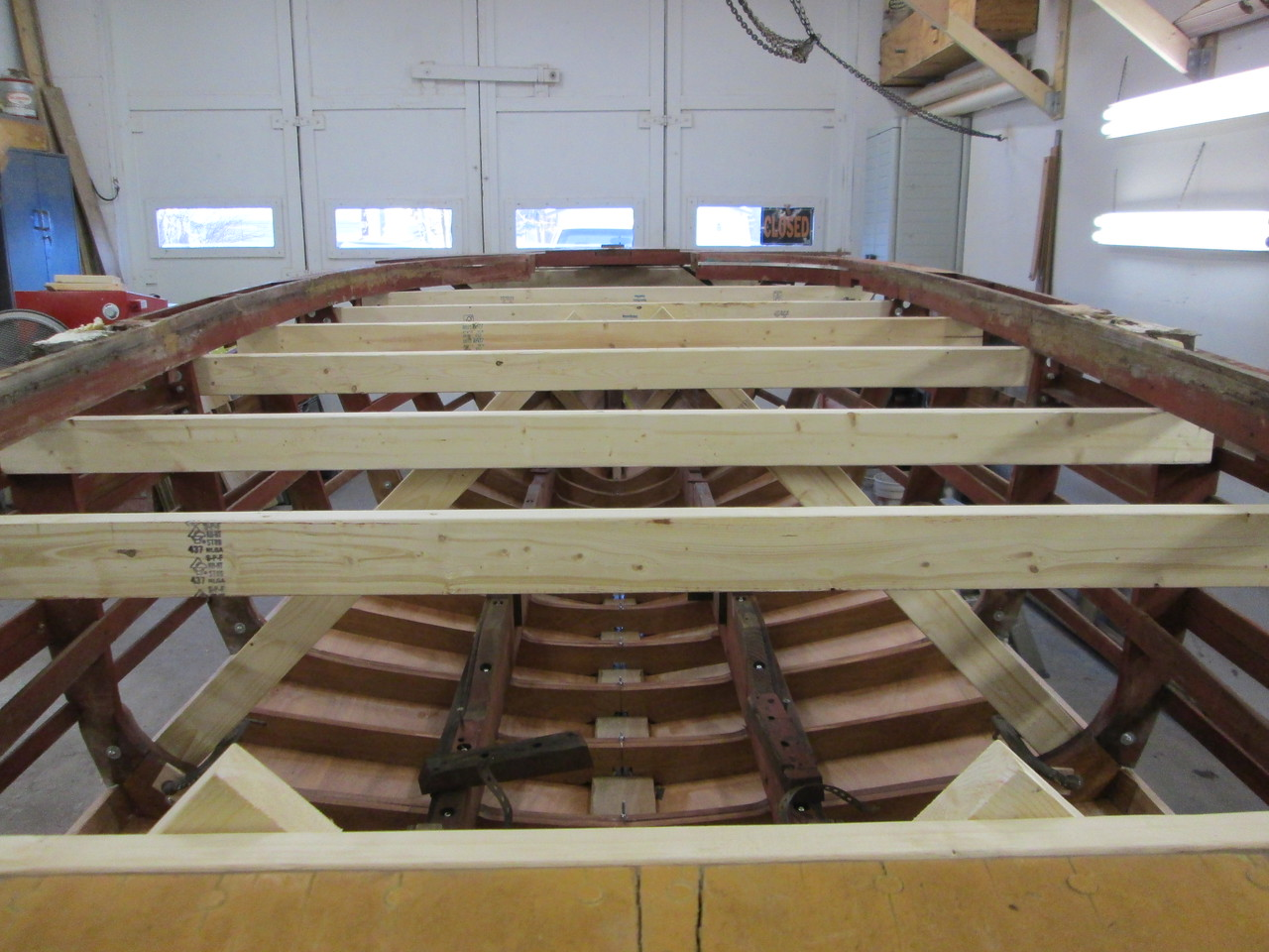 Temporary framing to hold the hull in shape while the sides and deck are removed.