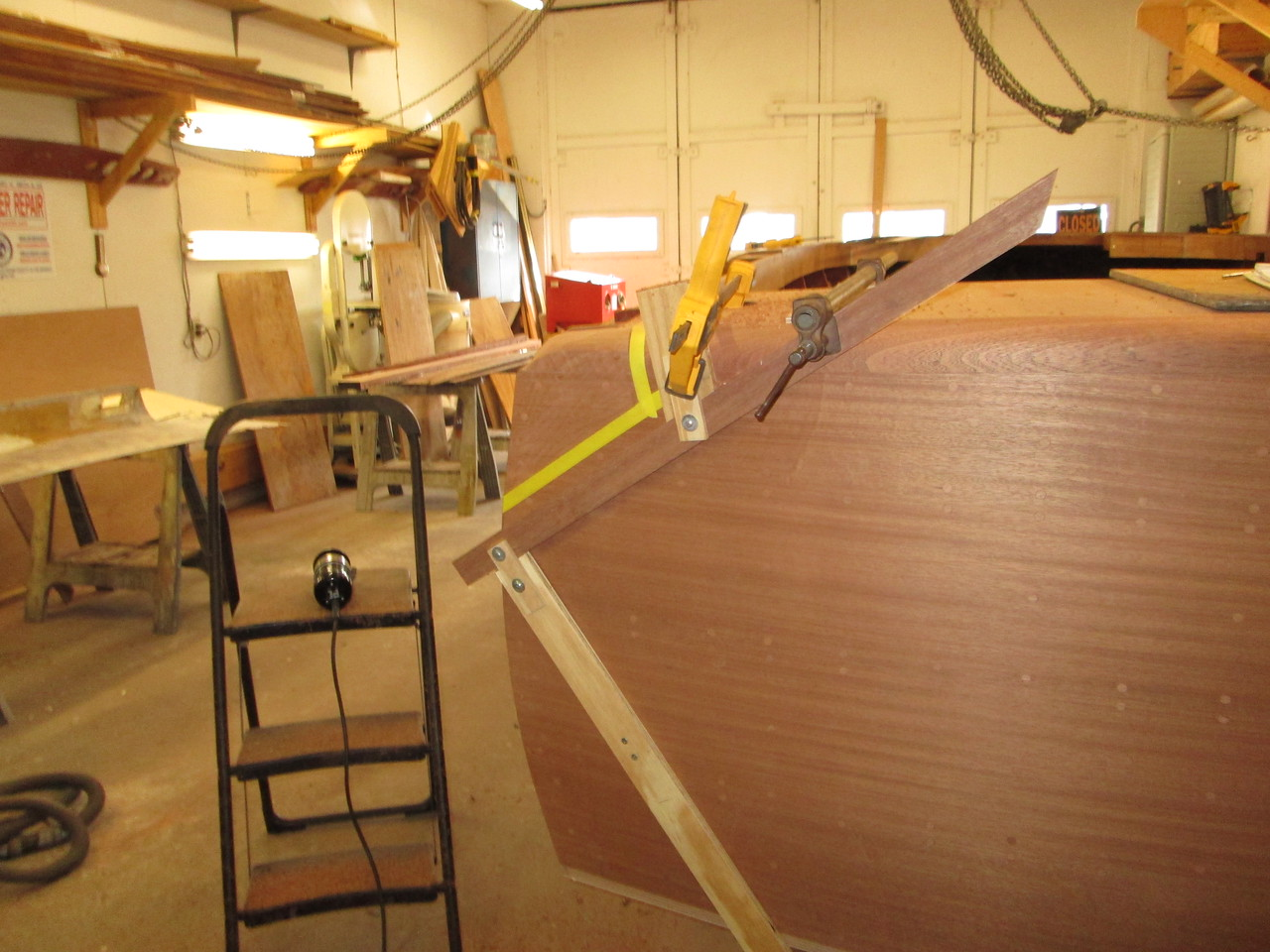 Router jig made and attached to the transom so the fin can be rabbited to the hull.