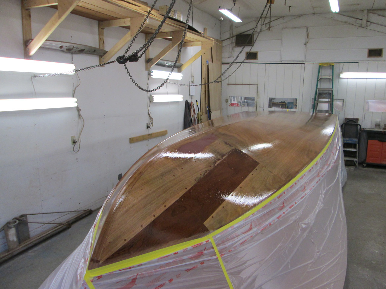 Front starboard view of the bottom with two coats of epoxy applied.