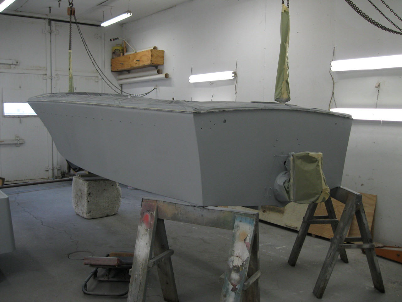 Port rear view of sides, bottom and transom primed.