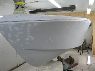 Port front view of primer being puttied and sanded.