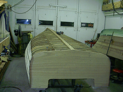 Starboard rear view of new ribs and keel cap installed. Also old skin removed.