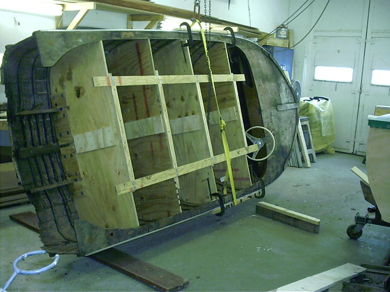 Turning hull upside down.
