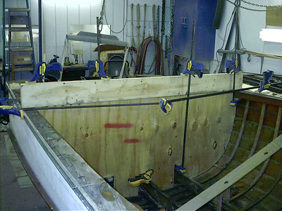 Building jigs and installing jigs to hold the hull in shape so it can be rebuilt.