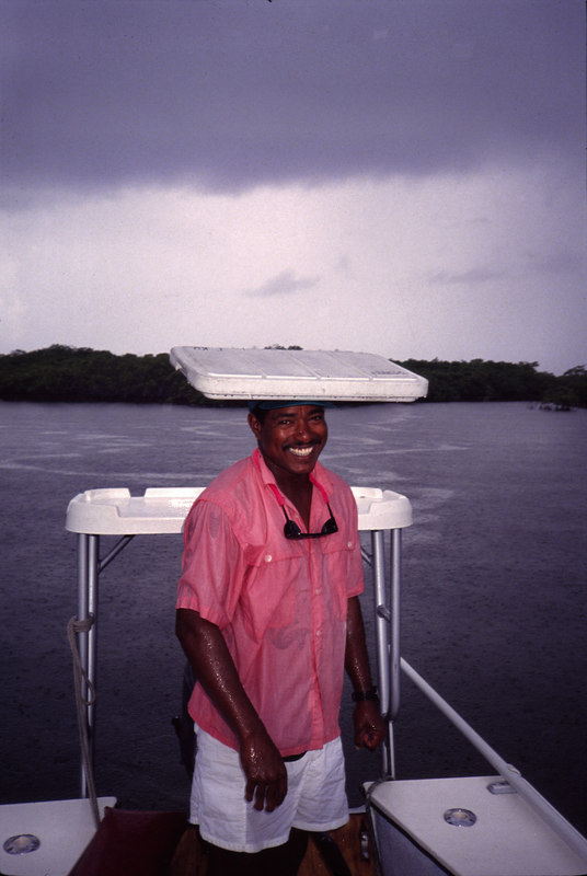 Guide Taku with a Belizean Rain Jacket. Fly Fishing Turneffe Belize