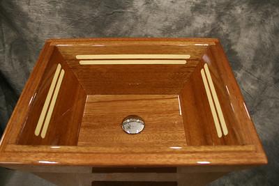 Mahogany vanity sink with holly inlays.