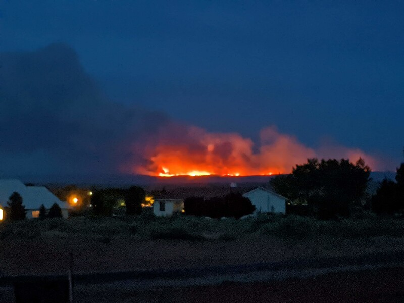 This photo was taken by Lou Pratt from his house in Kanab. The fire wa slikely 30 miles away as the crow flies
