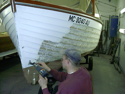Removing port side paint.