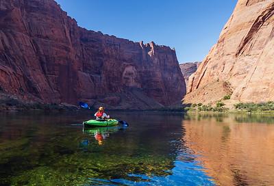 Kayaker Paddling Down Colorado River Near Horse Shoe Bend  in AZ