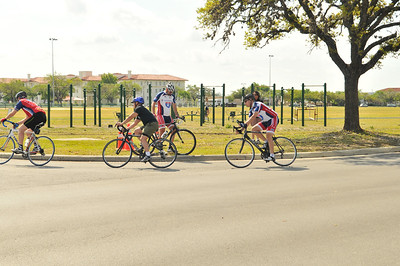 Participants are tested on bike handling techniques and group riding abilities during the Ride 2 Recovery Project HERO Training Camp in San Antonio, Texas.