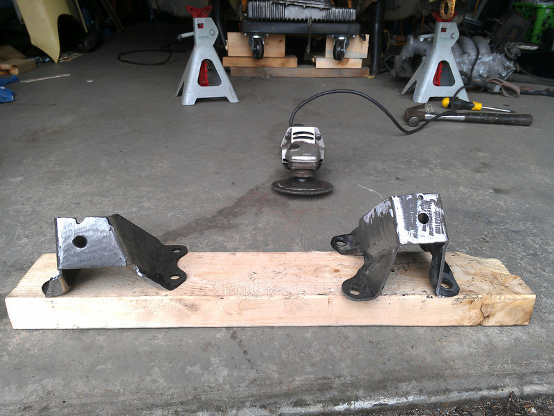 Stock SR motor mount brackets, all ground down and ready for some welding!