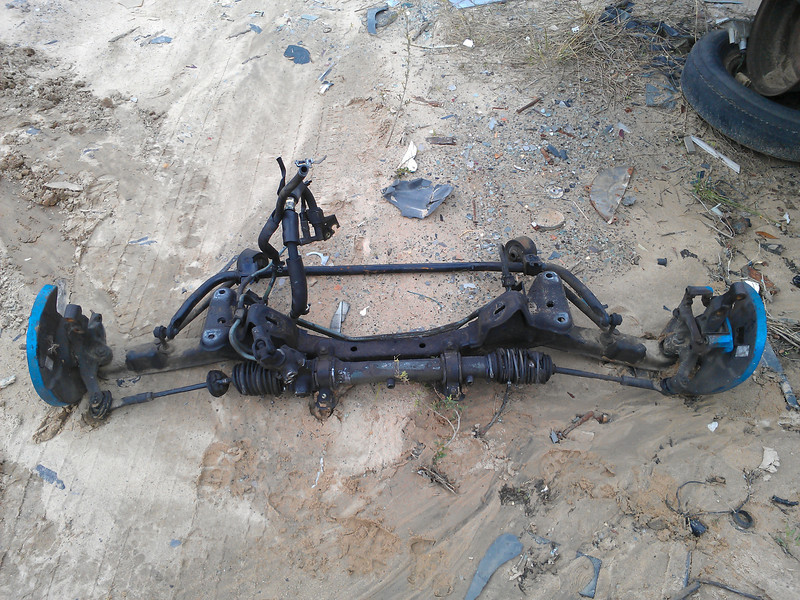 Had to go to a junkyard to source the S13 front crossmember, rack, tie rods, tension rods, hubs, etc