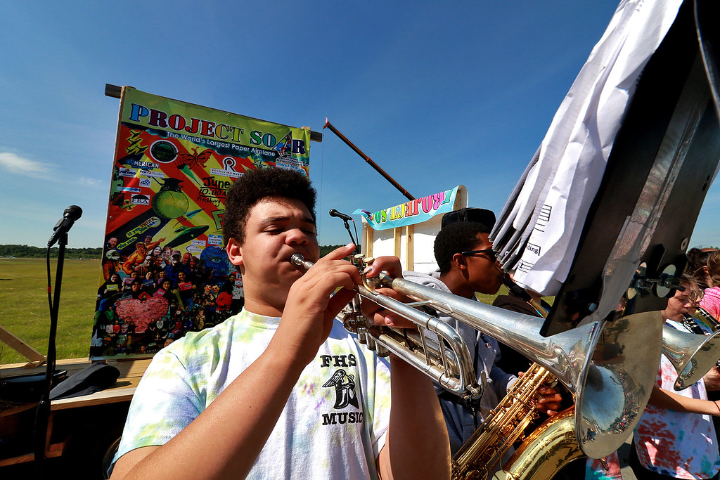. Jerry Beck\'s Project Soar launched at the Fitchburg Municipal Airport on Tuesday morning, June 12, 2018. Playing the trumpet with the Fitchburg High School band is Shaw DiGeronimo as they entertain the crowds during the event. SENTINEL & ENTERPRISE/JOHN LOVE