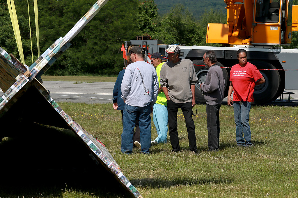 . Jerry Beck\'s Project Soar launched at the Fitchburg Municipal Airport on Tuesday morning, June 12, 2018. The plane sits on the ground as a crew works on fixing it after a mishap. SENTINEL & ENTERPRISE/JOHN LOVE