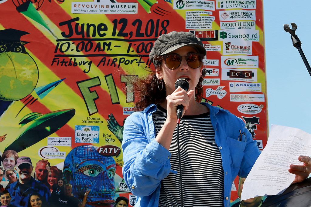 . Jerry Beck\'s Project Soar launched at the Fitchburg Municipal Airport on Tuesday morning, June 12, 2018. Artist Kathy Fanelli, who has one of the largest pieces of artwork on the plane, addresses the crowd at the event. SENTINEL & ENTERPRISE/JOHN LOVE