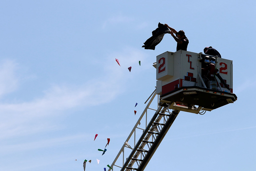 . Jerry Beck\'s Project Soar launched at the Fitchburg Municipal Airport on Tuesday morning, June 12, 2018. Some Fitchburg firefighter drop some paper airplanes from the bucket of a latter truck onto the field at the airport during the event SENTINEL & ENTERPRISE/JOHN LOVE
