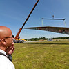 Jerry Beck's Project Soar launched at the Fitchburg Municipal Airport on Tuesday morning, June 12, 2018. Watching the plane as it hangs from a crane is Fitchburg Fire Lt. Rich Liberatore.SENTINEL & ENTERPRISE/JOHN LOVE