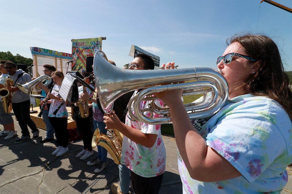 . Jerry Beck\'s Project Soar launched at the Fitchburg Municipal Airport on Tuesday morning, June 12, 2018. Playing the baritone with the Fitchburg High School band is Director Tabitha Greenlees as they entertain the crowds during the event. SENTINEL & ENTERPRISE/JOHN LOVE