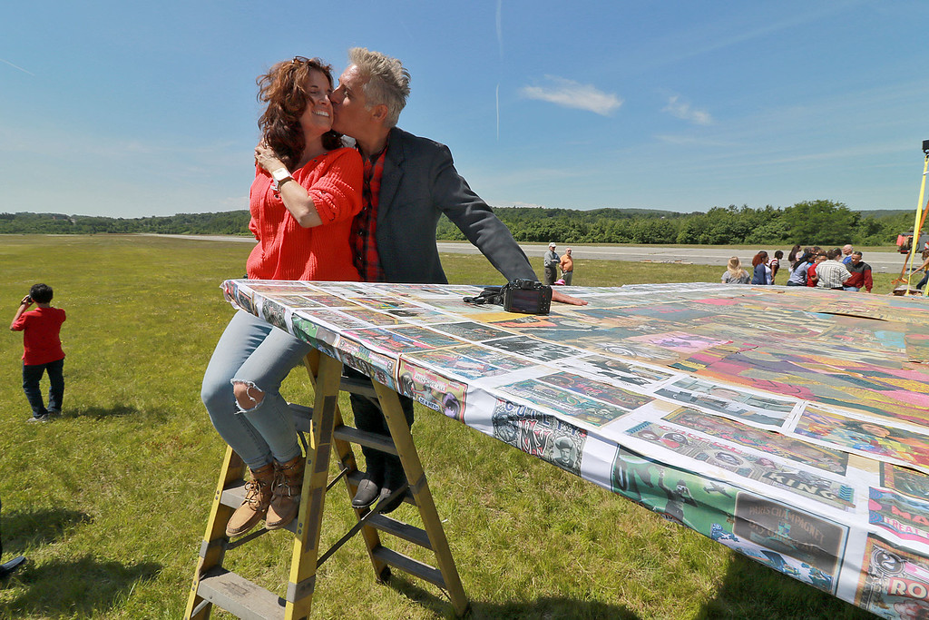 . Jerry Beck\'s Project Soar launched at the Fitchburg Municipal Airport on Tuesday morning, June 12, 2018. Beck gives his sister Robyn Buchwald a kiss as they stand on a ladder over loking the plane during the event. SENTINEL & ENTERPRISE/JOHN LOVE