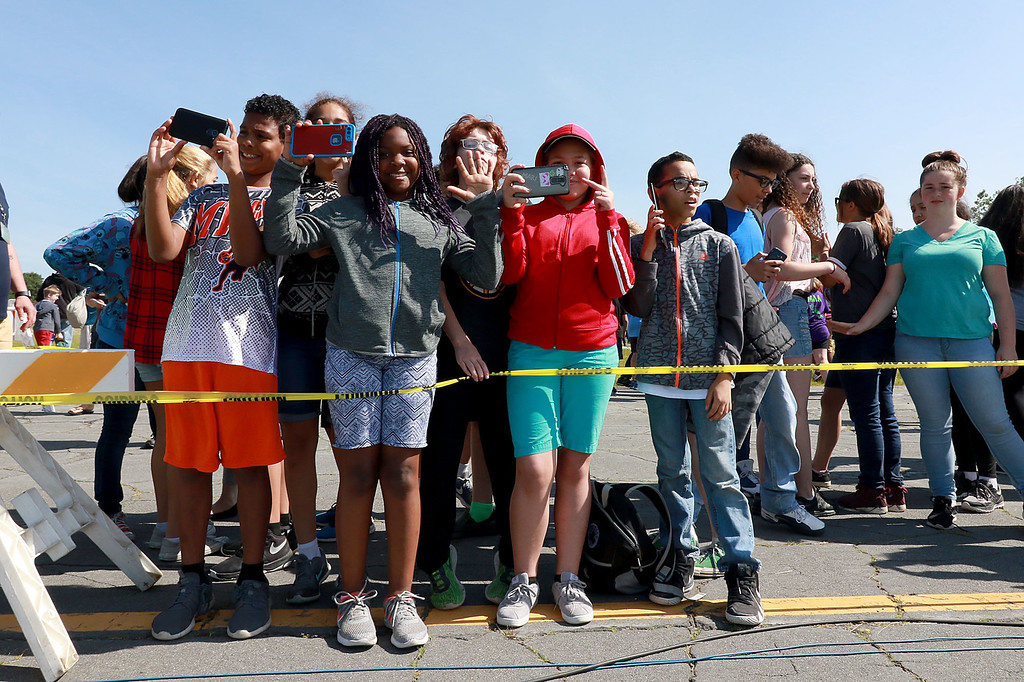 . Jerry Beck\'s Project Soar launched at the Fitchburg Municipal Airport on Tuesday morning, June 12, 2018. Students watch as the plane is lifted into the air. SENTINEL & ENTERPRISE/JOHN LOVE