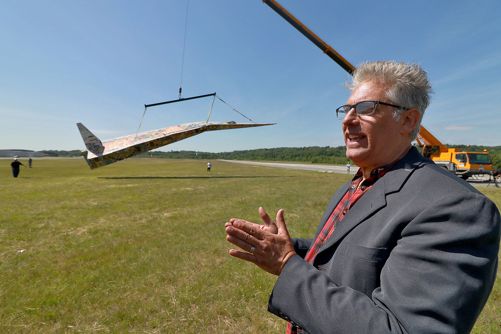 . Jerry Beck\'s Project Soar launched at the Fitchburg Municipal Airport on Tuesday morning, June 12, 2018. Beck looks as his plane is lifted back into the air after it was fixed. SENTINEL & ENTERPRISE/JOHN LOVE