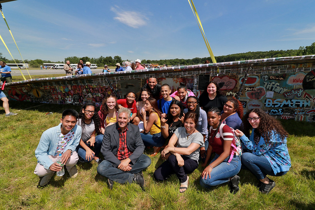 . Jerry Beck\'s Project Soar launched at the Fitchburg Municipal Airport on Tuesday morning, June 12, 2018. Beck, up front, poses with some students from Fitchburg High School near the plane during the event. SENTINEL & ENTERPRISE/JOHN LOVE
