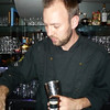 "Jan 11:  Mike Henderson, the Mixologist at TAG.  I was watching him create these amazing drinks - I don't think I have ever seen a true Mixologist at work, so when it was my turn I just said 'surprise me'  After asking some questions, he went and got a bottle of Rocky Mountain Peach Whiskey and made me this amazing drink.  When I asked him what we call it, he said, ""hmmmm - let's call it a Saint Peach"""
