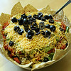 <b>Day 256—14 July 2012 Wendy, the domestic goddess</b>  I was impressed enough as Wendy assembled this layered salad in front of me. But, when she started arranging the chips around the edge it was just too much! She says I can be her grasshopper. As awesome as she is, I'm not sure even she's powerful enough to turn me into a domestic goddess.