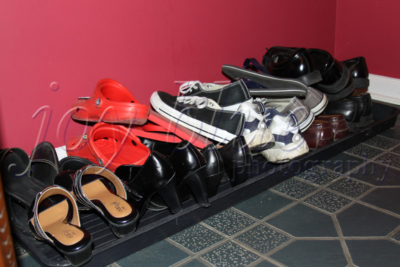 <b>Day 210—29 May 2012 Pile it on.</b>  In order for the foyer floor to be cleaned, the shoes have to be consolidated. It's not pretty, I know.