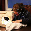 <b>Day 21—22 November 2011 Sewing with Susan</b>  Thanks to Facebook, I knew that our young friend Susan needed an iron and a sewing machine. She went to Sarah's for the iron, and came to our house to use the sewing machine. My trusty little Singer has served me well for nearly three-quarters of my life (though, as I don't do much more than sew straight lines, I don't ask much of it). It was great to have a visit with Susan. [APO brothers/sisters: Notice Susan's sweatshirt!]