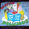 <b>Day 247—5 July 2012 Reading <i>is</i> so delicious!</b>  As a lifelong voracious reader, I'm absolutely nuts about our library (which also meets my DVD and CD needs). Today, I picked up my summer reading T-shirt.  I've completed every summer reading program from 1997 on (when NTS was 1—my energy and time for reading were hampered when I had babies in the house). Thanks, Friends of the Library!
