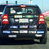 "<b>Day 31—2 December 2011 Can you hear him now?</b>  I don't often see a vehicle so thoroughly decorated. I couldn't read all of these stickers; but, one at right reads ""Jihad works both ways"" and bottom right says ""Free carbon credits suck here."" Very attractive, no?"