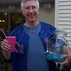 "<b>Day 227—15 June 2012 Bruce</b>  Bruce and Marguerite throw boss themed happy hours. Tonight we showed our baseball loyalties for ""Take me out to the ballgame."" Here, I caught Bruce as he was heading inside to refill the electric lemonade. As the designated driver, I can't attest to its flavor; but, I like the color."