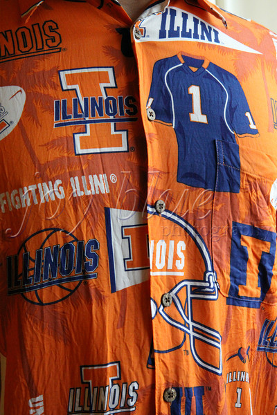 <b>Day 60—31 December 2011 Oskee Wow Wow, Illinois!</b>  The reward for the Fighting Illini's mediocre football season is the Kraft Fight Hunger Bowl. My dear husband is showing his support by wearing this rather spirited shirt, which he borrowed from NOS. It was a high school graduation gift from my sister and her husband (also alums). Go Illini; beat the Bruins!
