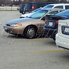 <b>Day 37—8 December 2011 Parking fail</b>  At my hot lunch date today, we were parked beyond this car—parked both the wrong direction (pulled through) <i>and</i> not even nearly in the space. As it was still there over an hour later, after my hunger had been satisfied, I took the opportunity to capture it. I can't believe it wasn't damaged, towed, ticketed, stickered, or written upon (dry-erase or china marker, anyone?).