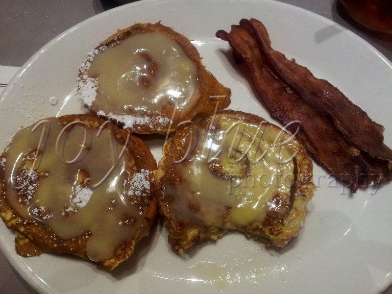 <b>Day 209—28 May 2012 Bonus brunch</b>  We enjoy a Sunday brunch tradition; but we took advantage of today's holiday to have a bonus brunch (here: Egg Harbor's cinnamon roll French toast and crispy bacon). It's a good thing we fueled up—DH and I went on a fruitless quest for lighting today. Our prime choices were closed and/or moved.