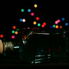 89/365<br /> <br /> Bottle and colorful holiday bokeh.