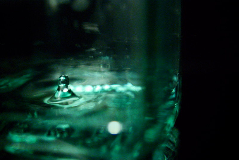 Insider Splash<br /> <br /> 54/365<br /> Splash inside the bottle. Not the clearest. The glass on my bottle is very distorting even from very close up.