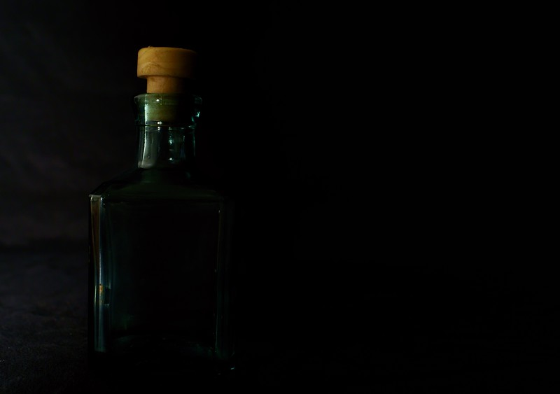 Dark Side of the Bottle (part 1)<br /> <br /> 41/365<br /> Lighting is one of my weaker photography skills. So I am practicing to make as perfect as I can get.
