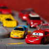 """Week 6: Ka-Chow - Week 6 - A movie or song title.  I spent most of the week just trying to decide which movie to create a photo for and what that photo would be.  James has been newly playing with these toys and especially Lighting McQueen, so when I saw """"Cars"""" in our Netflix Queue I knew exactly what I need to do.  For the hard light I used my pack strobes with a snoot on the main light and fills bounced off the wall to camera right."""