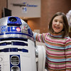 "Week 8: Laughing with the Droid - Week 8: Laughter.  This week I present my daughter, with R2D2, at a hockey game.  What could be more laughable than that?  Not the best photo I've taken, but it was a moment worthy of meeting the ""laughter"" theme."