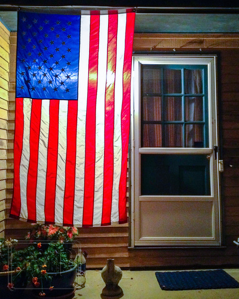 "Liberty at the Door - Week 22 ""Memorial Day""<br /> <br /> There were many ideas tossed around for the Memorial Day theme, but sometimes you just have to go with what you have.  I liked this giant American flag hanging at a friend's doorway and used it to fill this theme of remembrance."