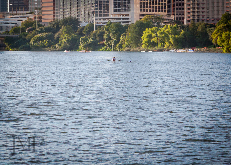 "Rowing - Week 30 ""Water""<br /> <br /> I spent this past week in Austin Texas, and I got to spend a bit of time out on a boat on the waters of Lake Austin.  This lake, a damned section of the Colorado River, traverses much of the downtown of the city itself.  I am often impressed to see just how many people there are out enjoying the lake at any given time.  Whether simply running along the shores or out for some serious rowing (like this man is doing), Lake Austin is clearly a well appreciated part of this city."