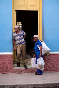 Andre, Leaning in the Doorway, and Juan (With Bags) Spending Some Quality Time