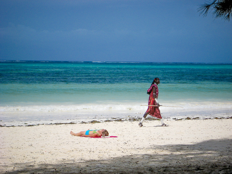 Maasai Guard Walking Along the Beach on the  Indian Ocean