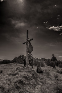 Interrupted Prayer at a Hilltop Cross