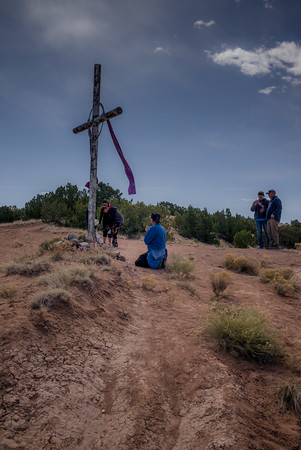 Pilgrim Praying at a Hilltop Cross