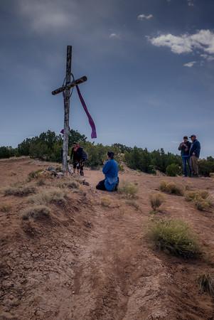 Pilgrim Praying at a Hilltop Cross