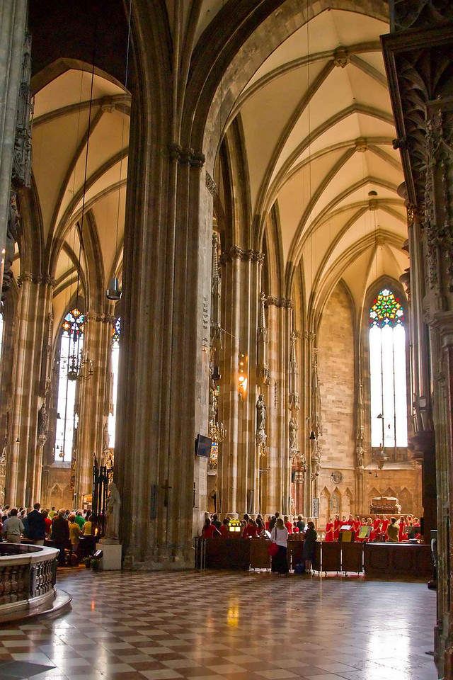Dozens of church-goers and tourists alike stayed for the concert after the noon mass in the Stephansdom in Vienna. You can get a sense of the scale of the cathedral from the size of the chorus who are in the south nave.